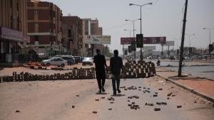 People walk on a street in Khartoum, Sudan, on Oct. 27, 2021. (Marwan Ali / AP)