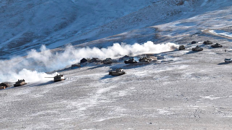 FILE - In this Feb. 10, 2021, file photo provided by the Indian Army, tanks pull back from the banks of Pangong Tso lake region, in Ladakh along the India-China border. . (Indian Army via AP, File)