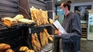 Baker Hugo Hardy prepares baguettes to be sold at Bigot bakery in Versailles, France, on Oct. 26, 2021. (Michel Euler / AP)