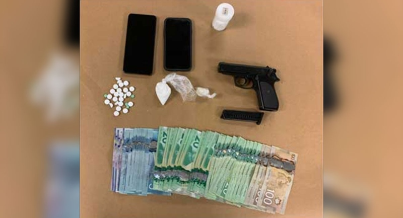 A replica gun, drugs and cash seized by police in London, Ont. on Tuesday, Oct. 26, 2021. (Source: London Police Service)