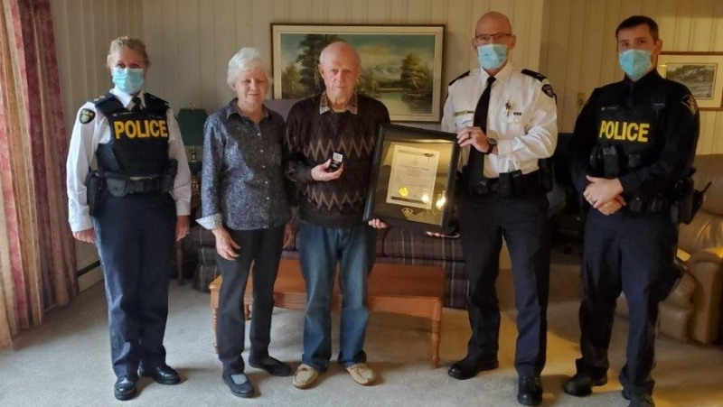 80 year-old Norman Ruff receives a Commissioners Citation for Bravery on October 26, 2021 (Courtesy: OPP)