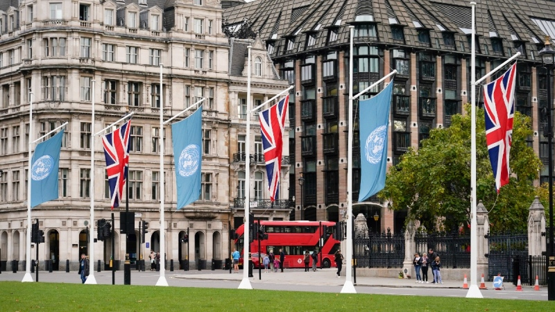 British and UN flags fly in Parliament Square, in London, Oct. 24, 2021. (AP/Alberto Pezzali)