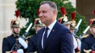 Poland's President Andrzej Duda walks past Republican Guards as he arrives at the Elysee Palace Wednesday, Oct. 27, 2021 in Paris. (AP Photo/Michel Euler)