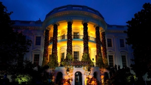 There won't be a White House Halloween celebration this year. In this October 2020 photo, the South Lawn of the White House is lit during a Halloween celebration. (Manuel Balce Ceneta / AP)