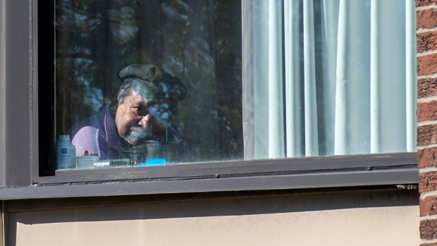 A resident gazes out his window in the morning sun at Hawthorn Place Care Centre in Toronto on Monday, May 10, 2021. Military documents obtained by The Globe and Mail indicate dozens of deaths at the facility from neglect, malnutrition and dehydration during the COVID19 pandemic. THE CANADIAN PRESS/Frank Gunn