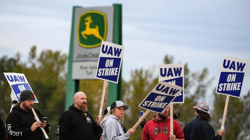 John Deere employees picket outside John Deere Davenport Works Thursday, Oct. 14, 2021, in Davenport, Iowa. Over 10,000 John Deere employees began their strike at 11:59 a.m. Wednesday. (Meg McLaughlin/Quad City Times via AP)