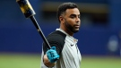 Tampa Bay Rays' Nelson Cruz swings a bat as he waits his turn in the batting cage during an American League Division Series baseball practice Oct. 6, 2021, in St. Petersburg, Fla. (AP/Chris O'Meara)