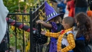 Children receive treats by candy chutes while trick-or-treating for Halloween in New York City on October 31, 2020. (Photo by David Dee Delgado/Getty Images)