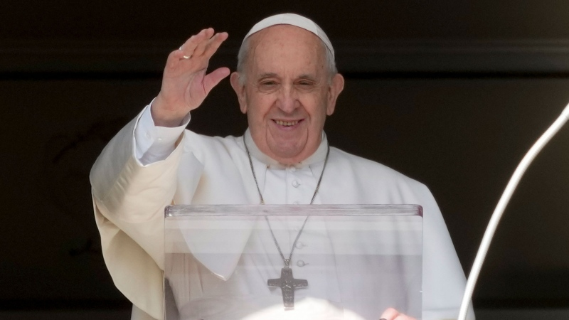 Pope Francis delivers his blessing as he recites the Angelus noon prayer from the window of his studio overlooking St.Peter's Square, at the Vatican, Sunday, Oct. 24, 2021. (AP Photo/Andrew Medichini)