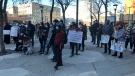 A group opposing changes to Saskatchewan's social assistance program protest in front of the Sturdy Stone building in Saskatoon on Oct. 27, 2021. (Francois Biber/CTV Saskatoon)