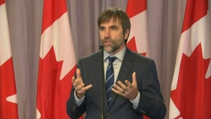 Canada's new minister of the environment and climate change Steven Guilbeault takes questions from reporters on Oct 27, 2021.