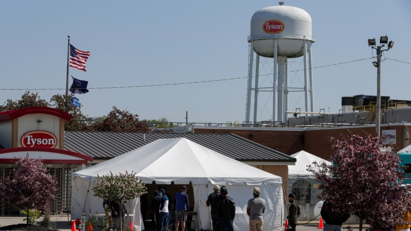 Workers wait in line to enter the Tyson Foods pork processing plant in Logansport, Ind., May 7, 2020. (AP/Michael Conroy)