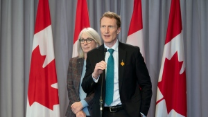 Indigenous Services Minister Patty Hajdu looks on as Crown-Indigenous Relations Minister Marc Miller responds to a question following a cabinet meeting, in Ottawa, Wednesday, Oct. 27, 2021. THE CANADIAN PRESS/Adrian Wyld