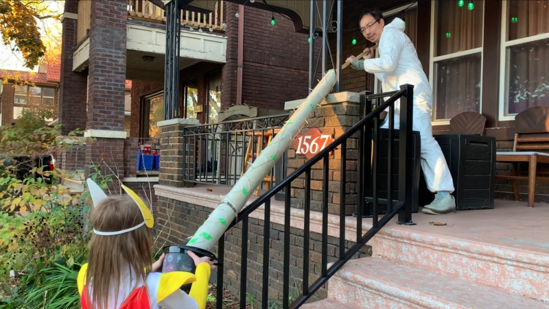 Anh Nguyen handing out candy at his house last Halloween in Windsor, Ont. on Saturday, Oct. 31, 2020. (Rich Garton/CTV Windsor)