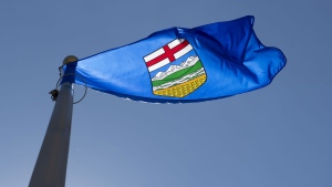 Alberta's provincial flag flies on a flag pole in Ottawa, Monday July 6, 2020. A recently-filed lawsuit against the Kenney government by a former senior staffer alleges inappropriate conduct within the premier's government. (THE CANADIAN PRESS/Adrian Wyld)