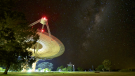 The Parkes observatory is positioned to be isolated from radio frequency interference. The site also sees dark skies in optical light, as seen here in June 2017 with the Milky Way Galaxy overhead. (Daniel John Reardon)