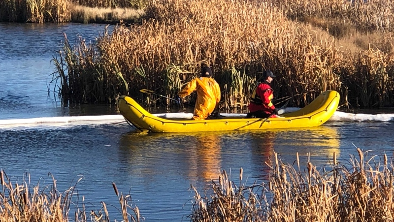 Fire crews work to contain an oil spill in a north Edmonton stormwater facility on Oct 27, 2021. (John Hanson/CTV News Edmonton)
