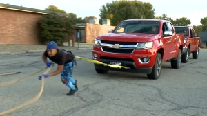 10-year-old power lifter drags two trucks