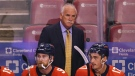 Florida Panthers head coach Joel Quenneville looks on from the bench during the first period of an NHL hockey game against the Colorado Avalanche, Oct. 21, 2021, in Sunrise, Fla. (AP Photo/Jim Rassol)