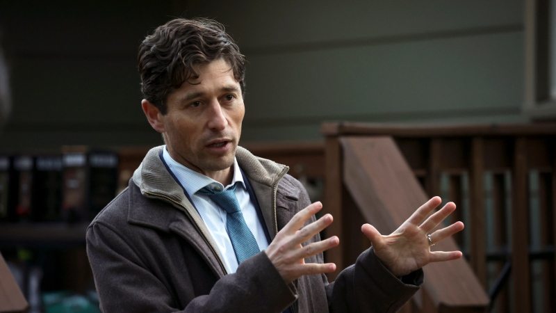 """Minneapolis Mayor Jacob Frey speaks to his constituents at his """"Mayor on the Block"""" event on Tuesday, Oct. 26, 2021, in Minneapolis. (AP Photo/Christian Monterrosa)"""