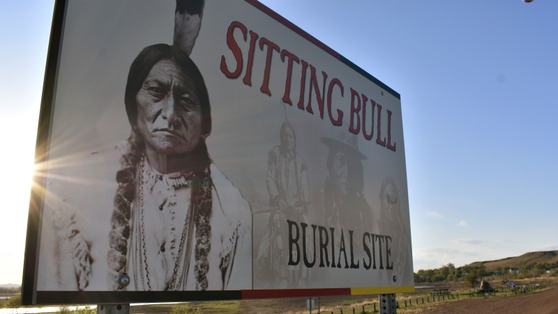 In this May 20, 2021, photo a banner for the burial site of Sitting Bull is seen in the Standing Rock Sioux Reservation in Fort Yates in North Dakota. (AP Photo/Matt Brown)