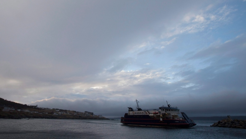 A ferry is seen arriving from Bell Island to Portugal Cove, N.L. during the last moments of daylight Tuesday, Dec. 29, 2009. THE CANADIAN PRESS/Jonathan Hayward