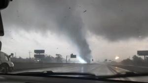 Watch a tornado rip across a Texas highway