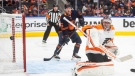 Philadelphia Flyers goalie Carter Hart (79) makes the save as Edmonton Oilers' Kailer Yamamoto (56) looks for the rebound during second period NHL action in Edmonton on Wednesday, October 27, 2021.THE CANADIAN PRESS/Jason Franson