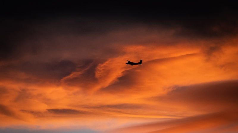 A small plane takes off from Vancouver International Airport at sunset, in Richmond, B.C., Monday, Oct. 25, 2021. (THE CANADIAN PRESS / Darryl Dyck)