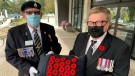 London, Ont. Mayor Ed Holder is presented with the first poppy of this year's local campaign at City Hall on Thursday, Oct. 28, 2021. (Bryan Bicknell / CTV News)