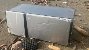 A refrigerator believed to have washed ashore from the Zim Kingston cargo ship on northern Vancouver Island. (Jerika McArter)