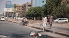 People walk on a street in Khartoum, Sudan, two days after a military coup, Oct. 27, 2021. (AP/Marwan Ali)