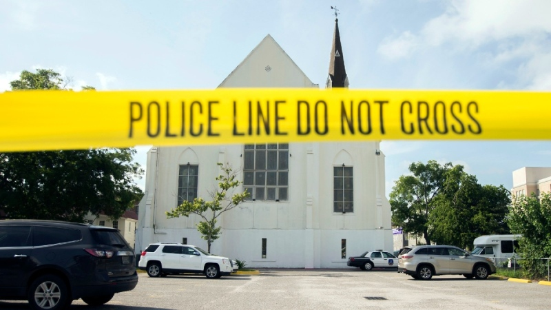 Police tape surrounds the parking lot behind the AME Emanuel Church in Charleston, S.C., on June 19, 2015. (Stephen B. Morton / AP)
