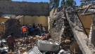 Residents sift through rubble from a destroyed building at the scene of an airstrike in Mekele, in the Tigray region of northern Ethiopia Thursday, Oct. 28, 2021. (AP Photo)