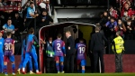 Barcelona's head coach Ronald Koeman, centre, heads back down the tunnel at the end of the Spanish La Liga soccer match between Rayo Vallecano and FC Barcelona, on Oct. 27, 2021. (Manu Fernandez / AP)