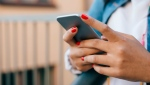 A stock photo of a teenage girl using mobile phone. (Getty Images)