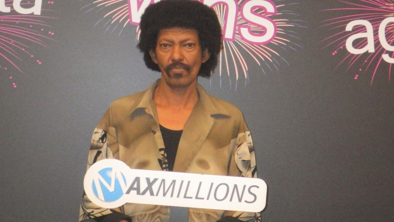 Osman Adam said he couldn't believe his eyes when he scanned his Lotto Max ticket and discovered he had won. (Western Canada Lottery Corporation)