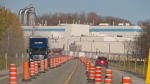 The two workers who died after a multi-storey scaffold collapsed at a Domtar paper mill in Quebec have been identified. Vehicles travel down a roadway nearby the Domtar paper mill in Windsor, Que., Thursday, Oct. 28, 2021. THE CANADIAN PRESS/Perry Beaton