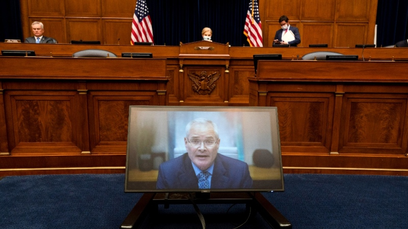 Darren Woods, CEO of ExxonMobil, testifies via video conference during a House Committee on Oversight and Reform hearing on the role of fossil fuel companies in climate change, Oct. 28, 2021, on Capitol Hill in Washington. (Jacquelyn Martin / AP)