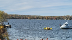 Emergency crews search the water after a vehicle plunged into Georgian Bay in Midland, Ont., on Thurs., Oct. 28, 2021 (OPP_CR)
