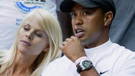 Tiger Woods and his wife, Elin, take in Game 4 of the NBA finals in this June 11, 2009 file photo taken in Orlando, Fla. Woods was injured Friday when he lost control of his SUV  (AP Photo/David J. Phillip, File)