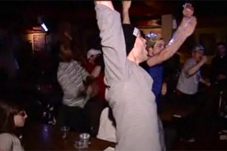 Montreal Alouettes fans at a downtown bar jump to their feet after the Als defeat the Saskatchewan Roughriders 28-27 on Sunday, November 29, 2009.