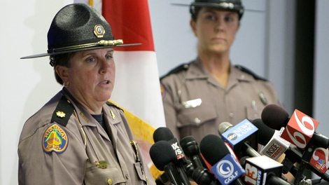 Maj. Cindy Williams, left, with the Florida Highway Patrol speaks during a news conference concerning Tiger Woods' accident as Sgt. Kim Montes looks on in Orlando, Fla., Tuesday, Dec. 1, 2009. (AP / John Raoux)