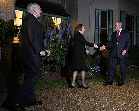 U.S. President George W. Bush, right, is greeted by Australian Prime Minister John Howard, left, and his wife, Janette, outside Kirribilli House in Sydney on Wednesday, Sept. 5, 2007. (AP Photo/Adrees Latif, POOL)