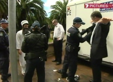 Members of a TV comedy show, which airs on the Australian Broadcasting Corp. are searched by security at the APEC summit in Sydney on Thursday, Sept. 6, 2007.
