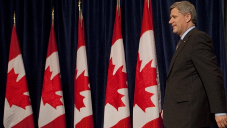 Prime Minister Stephen Harper arrives to a news conference in Beijing, China on Wednesday, Dec. 2, 2009. (Sean Kilpatrick / THE CANADIAN PRESS)
