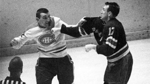 Bob Nevin is seen here fighting with John Ferguson in this file photo from 1964. Nevin has died at the age of 82. (File)