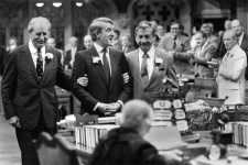 Conservative leader Brian Mulroney is given a standing ovation by Prime Minister Pierre Trudeau (R) while being escorted into the House of Commons Sept. 12, 1983. (CP / Andy Clark)