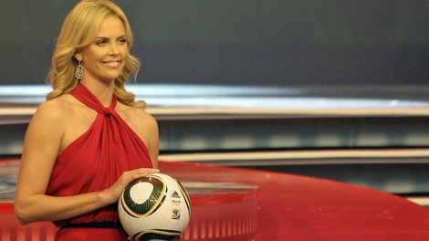 Actress Charlize Theron holds the official match ball  Jabulani  during the  2010 World Cup 81d9d3b44cd02
