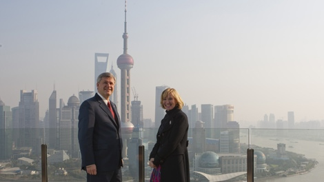 Prime Minister Stephen Harper and wife Laureen look out over Shanghai, China on Saturday, December 5, 2009. (Sean Kilpatrick / THE CANADIAN PRESS)